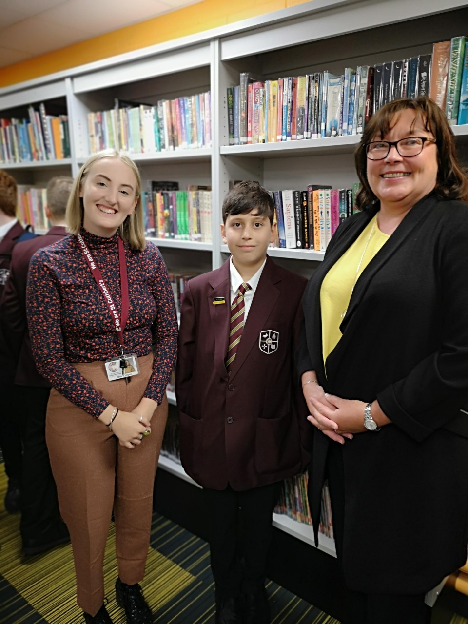 Adem, our very own multi-millionaire, Accelerated Reader Champion with Miss Magee and Mrs Twist at the grand opening of the library.